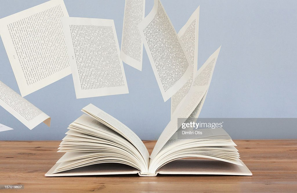 pages of a book flying away in the wind ストックフォト getty images