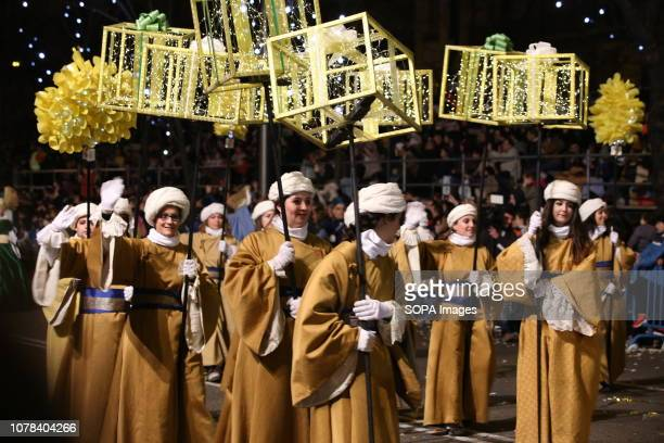 28001 MADRID MADRID SPAIN Pages of the Melchor King seen wearing traditional costumes from the East as they cross the Paseo de Plaza Colon during the...