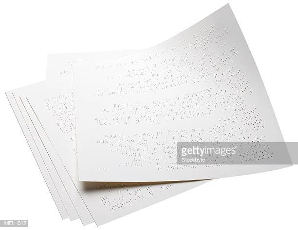 Pages with braille writing on them