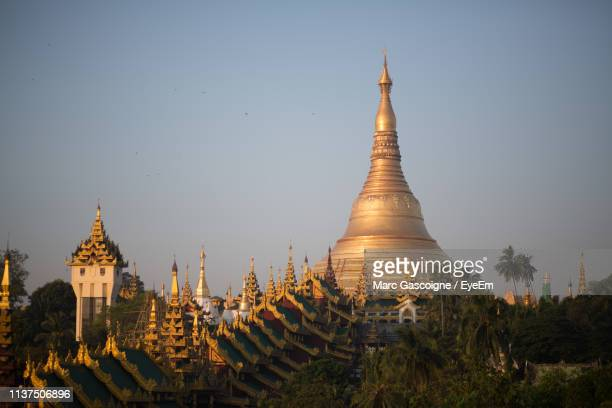 pagoda against clear sky - yangon stock pictures, royalty-free photos & images