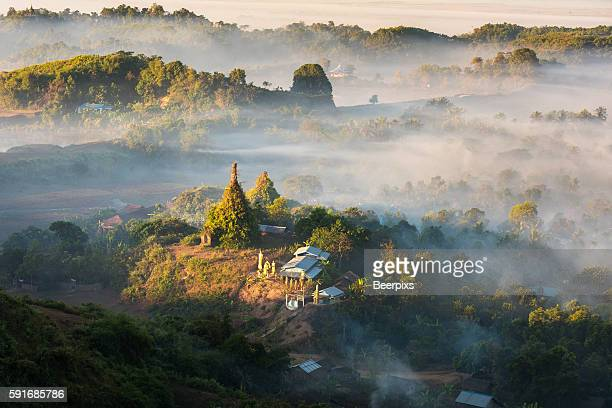 Pagoda and temple in the mist in Mrauk U, Myanmar. In the Morning time.