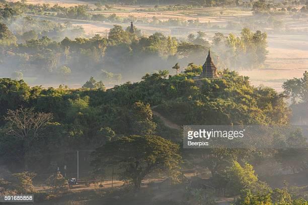 Pagoda in the mist in Mrauk U, Myanmar. In the Morning time.