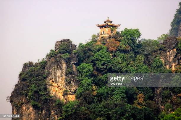 A pagoda on a cliff in the city of Yangshuo China