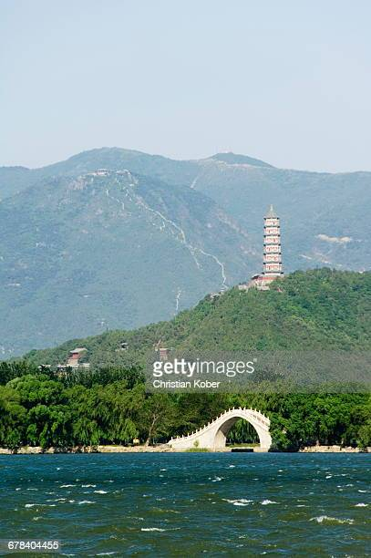A pagoda on Yuquan Mountain seen across Kunming Lake at Yihe Yuan (The Summer Palace), UNESCO World Heritage Site, Beijing, China, Asia