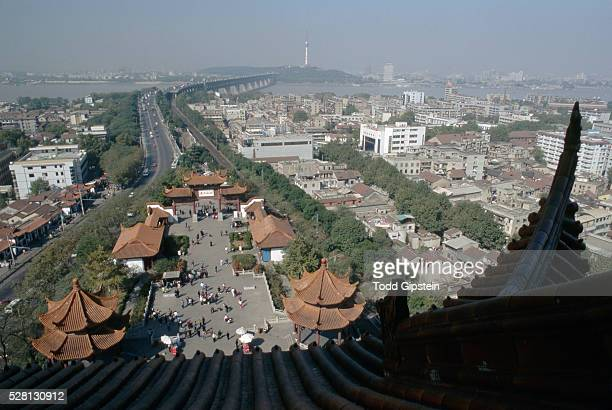 pagoda rooftops and plaza - wuhan stock photos and pictures