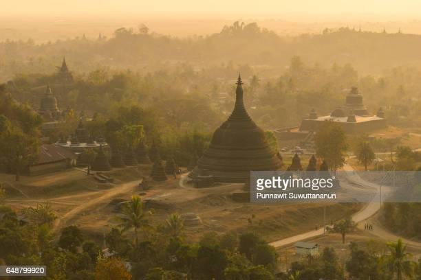 pagodas at north of mrauk u at sunset, rakhine state, myanmar - sittwe stock photos and pictures