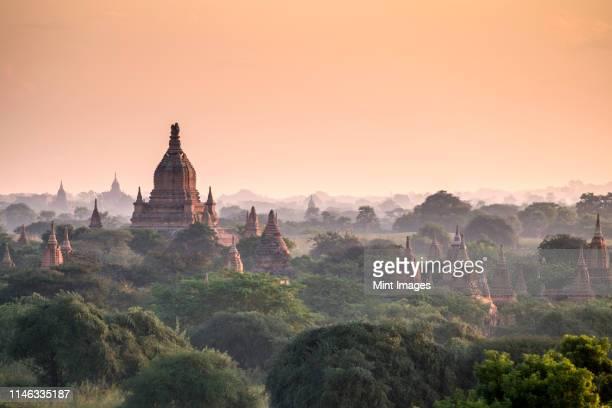 pagodas in landscape - pagode stock-fotos und bilder