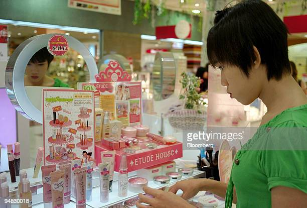 Paiboon Marvin examines beauty products at a cosmetics counter in a shopping mall outside of Bangkok Thailand on Saturday July 26 2008 Paiboon...