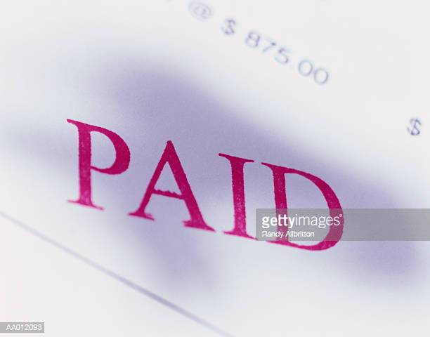 paid stamped on an invoice - paid stock pictures, royalty-free photos & images