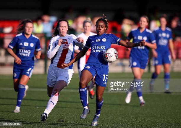 Paige Bailey-Gayle of Leicester City is closed down by Aoife Hurley of Crystal Palace during the Barclays FA Women's Championship match between...