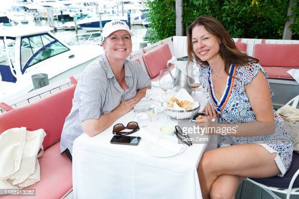 Paige Boller and a guest attend the Nicole Miller Walk N' Rosé Event With Group For The East End on August 18 2019 in Sag Harbor New York