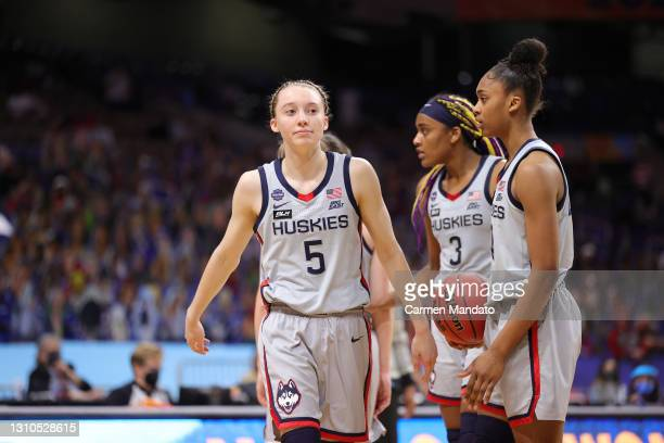 Paige Bueckers of the UConn Huskies reacts against the Arizona Wildcats during the third quarter in the Final Four semifinal game of the 2021 NCAA...