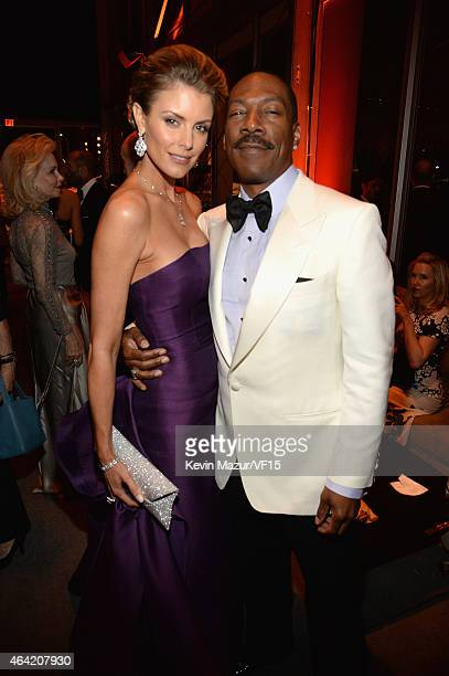 Paige Butcher and Eddie Murphy attend the 2015 Vanity Fair Oscar Party hosted by Graydon Carter at the Wallis Annenberg Center for the Performing...