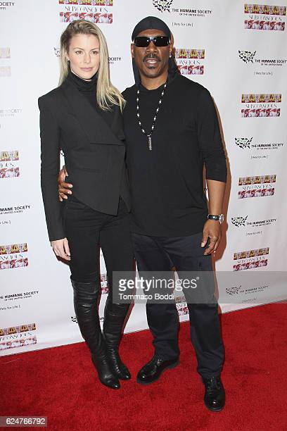 Paige Butcher and Eddie Murphy attend the Debut Gallery Opening Of Bria Murphy's 'Subconscious' at Los Angeles Contemporary Exhibitions on November...