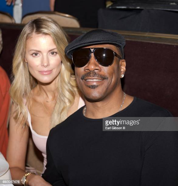 Paige Butcher and Eddie Murphy attend the Ladylike Foundation's 9th Annual Women Of Excellence Awards Gala at The Beverly Hilton Hotel on June 3 2017...