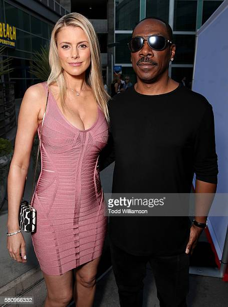 Paige Butcher and Eddie Murphy attend the Premiere Of Cinedigm's Amateur Night at ArcLight Hollywood on July 25 2016 in Hollywood California