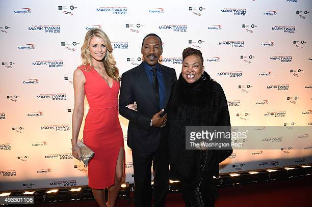 Paige Butcher left and Eddie Murphy center and Murphy's mother Lillian Murphy right are seen on the red carpet at the Kennedy Center for the Mark...