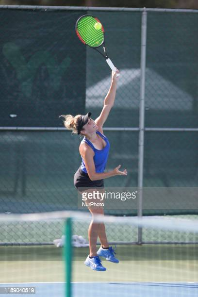 Paige Cline of USA plays a backhand in the match Singles Finals against Nika Kukharchuk of Russia during The World Tennis Tournament Cancun 2019 on...