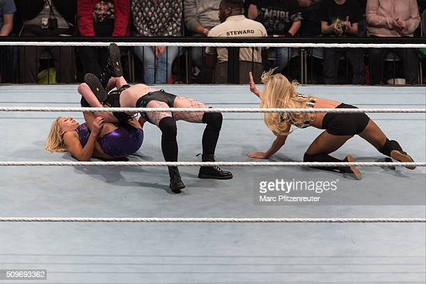 Paige competes in the ring against Charlotte at the Road to WrestleMania at the Lanxess Arena on February 11 2016 in Cologne Germany