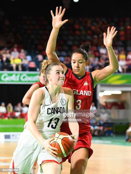 Paige Crozon of Canada drives to the basket past Azania Stewart of England during the womenÕs Pool A Basketball match between England and Canada on...