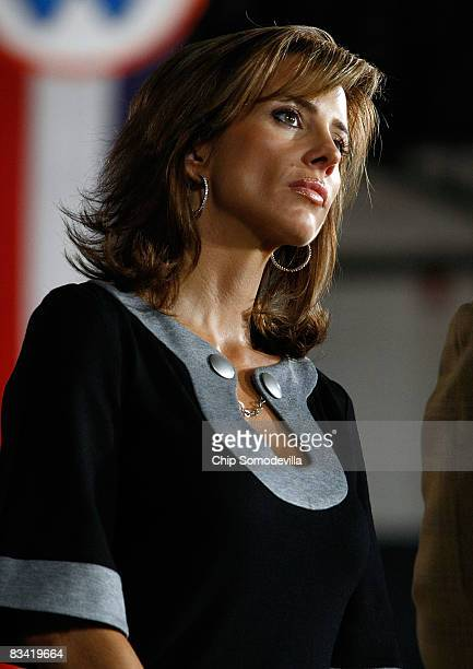 Paige Green fiancee of former Denver Broncos quarterback John Elway listens to Republican presidential nominee Sen John McCain during a campaign...