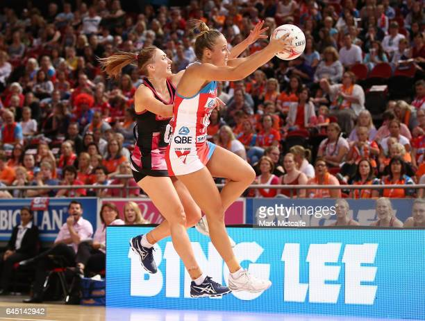 Paige Hadley of the Swifts and Gia Abernethy of the Thunderbirds contest possession during the round two Super Netball match between the Sydney...