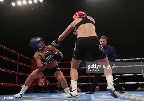 Paige Hareb ducks a punch from Hayley Holt during the Fight For Life League vs Union Night at The Trusts Stadium on December 3 2011 in Auckland New...