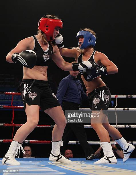 Paige Hareb punches Hayley Holt during the Fight For Life League vs Union Night at The Trusts Stadium on December 3 2011 in Auckland New Zealand