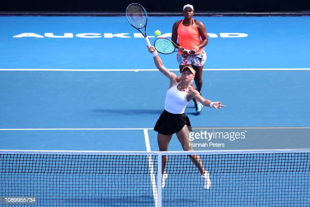 Paige Hourigan of New Zealand plays a forehand with partner Taylor Townsend of USA during the Women's doubles semi final against Kirsten Flipkens of...