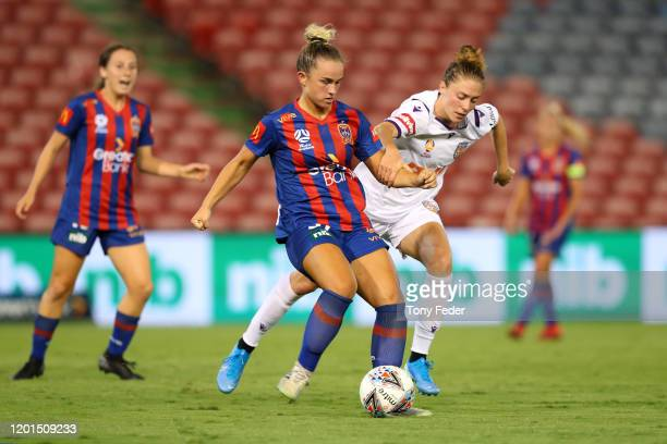Paige Kingston-Hogg of the Newcastle Jets contests the ball with Celia Jimenez of Perth Glory during the round 11 W-League match between the...