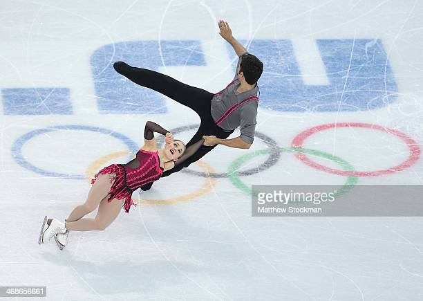 Paige Lawrence and Rudi Swiegers of Canada compete during the Figure Skating Pairs Short Program on day four of the Sochi 2014 Winter Olympics at...