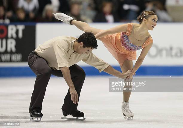 Paige Lawrence and Rudi Swiegers of Canada skate in the pairs short program at the 2012 Skate Canada International ISU Grand Prix event in Windsor...