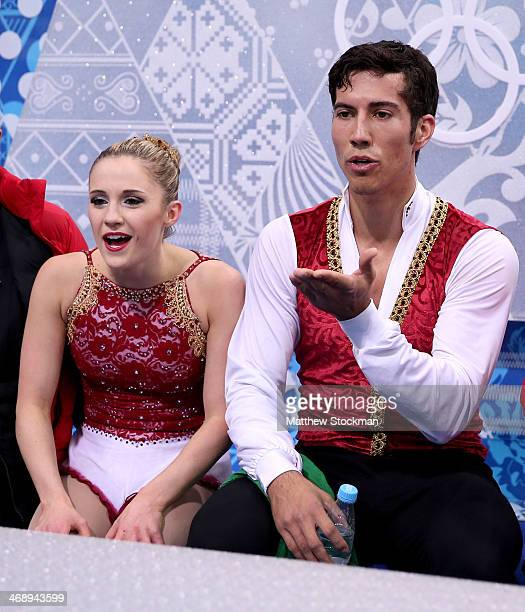 Paige Lawrence and Rudi Swiegers of Canada wait for their score during the Figure Skating Pairs Free Skating during day five of the 2014 Sochi...