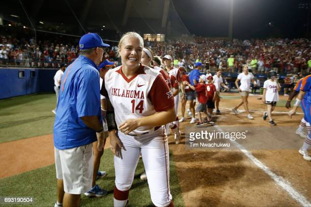 Paige Lowary of the University of Oklahoma can't hold back her smile after shaking hands with the University of Florida head coach Tim Walton after...