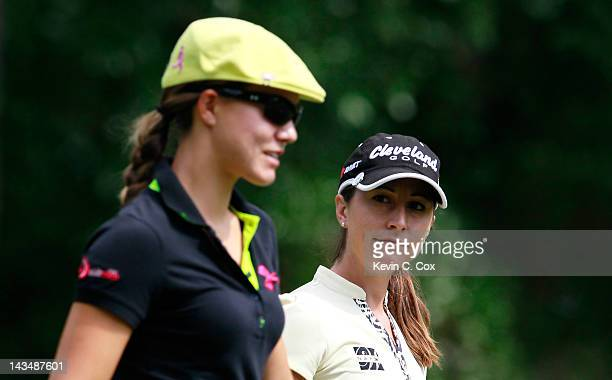 Paige Mackenzie converses with HeeWon Han of South Korea as they walk the seventh hole during the second round of the Mobile Bay LPGA Classic at the...