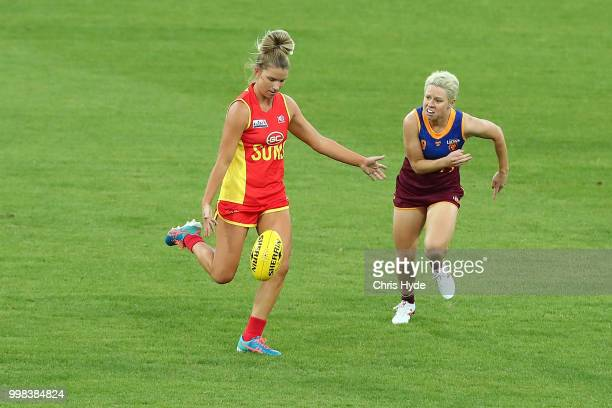 Paige Parker of the Suns kicks during the AFLW Winter Series match between the Gold Coast Suns and the Brisbane Lions at Metricon Stadium on July 14...
