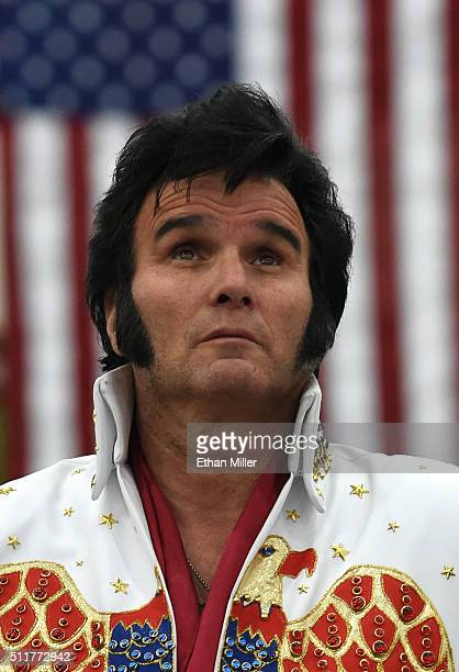 Paige Pool of Nevada dressed as Elvis Presley watches a video before a rally for Republican presidential candidate Donald Trump at the South Point...