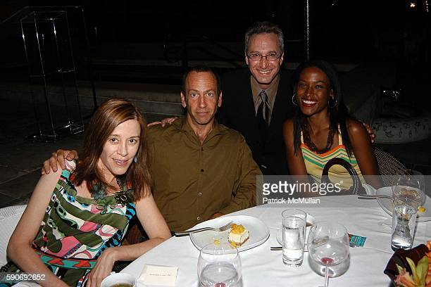 Paige Powell Kenny Scharf and Nicola Vassell attend Basquiat Exhibition Preview at MOCA on July 15 2005 in Los Angeles CA
