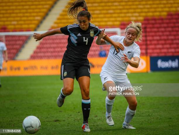 Paige Satchell of New Zealand fights for the ball with Adriana Sachs of Argentina during the Women's Cup of Nations football match between New...