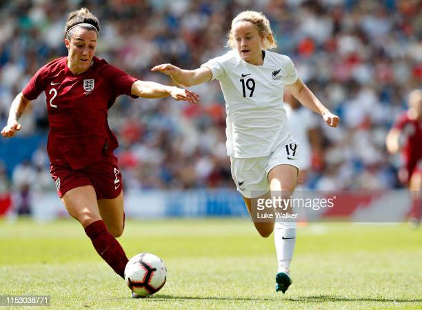 Paige Satchell of New Zealand is challenged by Lucy Bronze of England Women during the International Friendly between England Women and New Zealand...