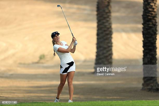 Paige Spiranac of the United States plays her second shot on the 14th hole during the first round of the 2016 Omega Dubai Ladies Masters on the...