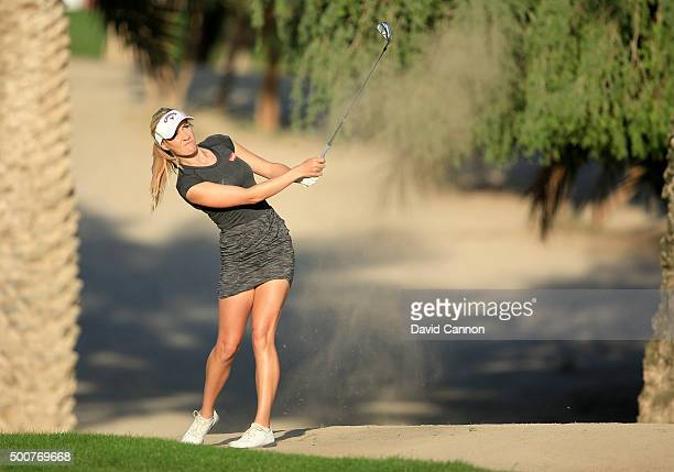 Paige Spiranac of the United States plays her second shot on the par 4, 14th hole during the second round of the 2015 Omega Dubai Ladies Masters on...