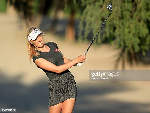 Paige Spiranac of the United States plays her second shot on the par 4 14th hole during the second round of the 2015 Omega Dubai Ladies Masters on...