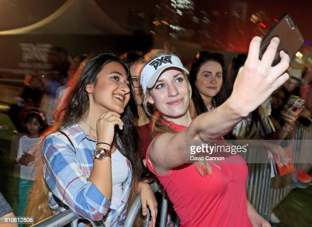 Paige Spiranac of the United States takes a selfie with a fan at the Omega Constellation Clinic after play during the second round of the Omega Dubai...