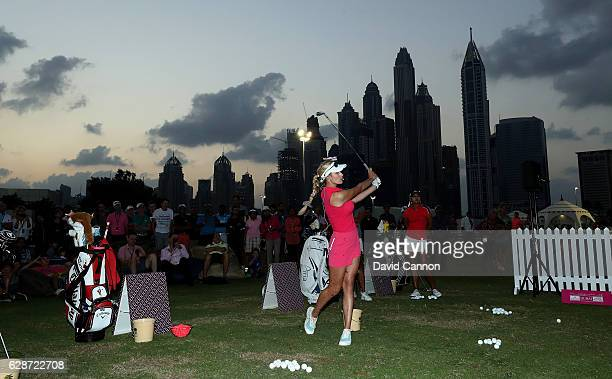 Paige Spiranac of the United States takes part in the 'Pink Stars Clinic' after play in the delayed second round of the 2016 Omega Dubai Ladies...