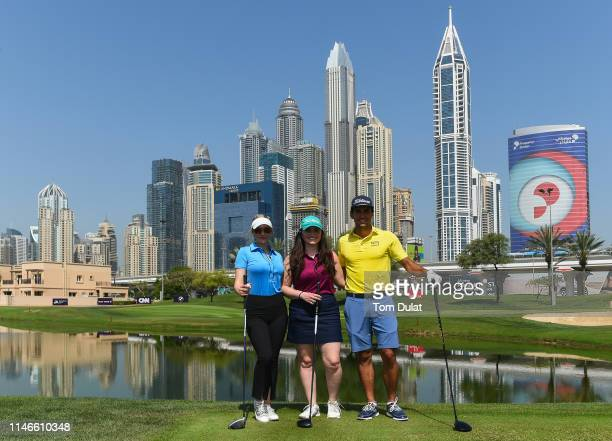 L_R Paige Spiranac of United States competition winner Sara Wiedenhaefer and Rafa Cabrera Bello of Spain pose for photographs during Day Three of the...