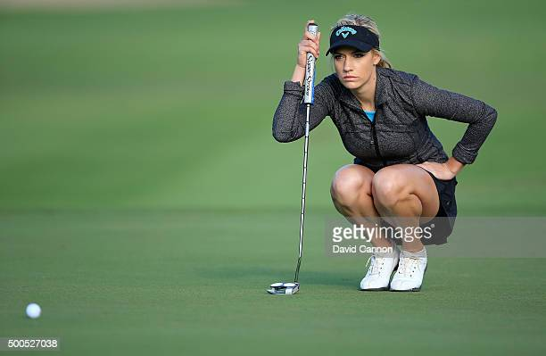 Paige Spiranac of United States lines up a par putt at the par 5, 10th hole during the first round of the 2015 Omega Dubai Ladies Masters on the...