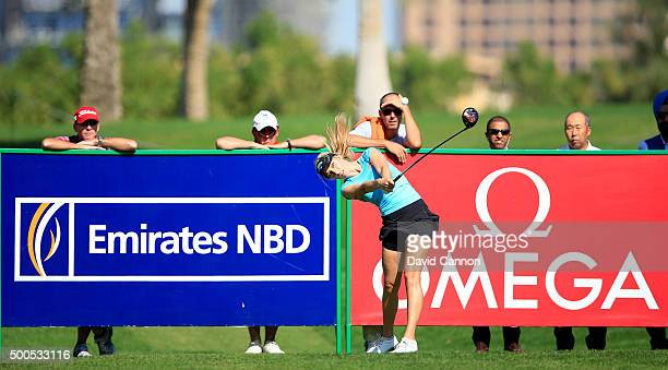Paige Spiranac of United States plays her tee shot at the par 4 9th hole during the first round of the 2015 Omega Dubai Ladies Masters on the Majlis...