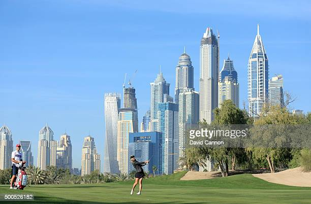 Paige Spiranac of United States plays her third shot at the par 5, 13th hole during the first round of the 2015 Omega Dubai Ladies Masters on the...