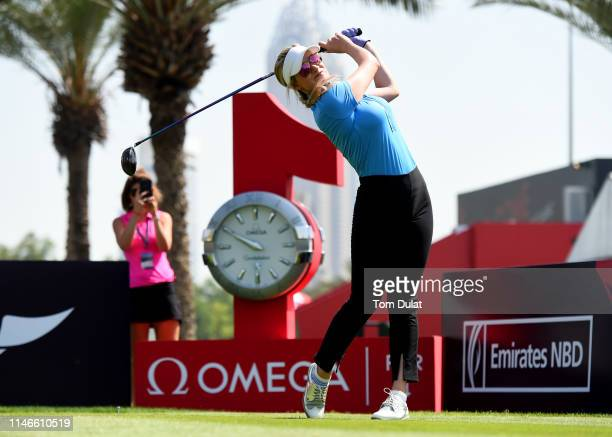 Paige Spiranac of United States tees off from the 1st hole during Day Three of the Omega Dubai Moonlight Classic at Emirates Golf Club on May 03,...